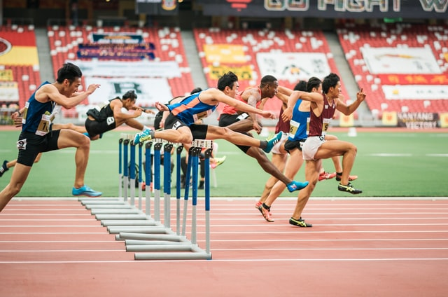 Hurdlers on a track