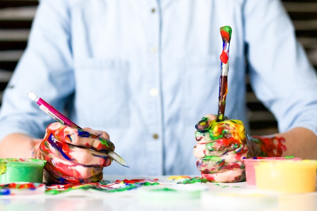 Messy paints and paintbrush